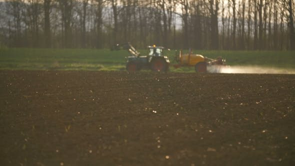 Cover Image for Tractor Spray Fertilize On Field With Chemicals In Agriculture Field.