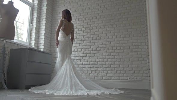 Thumbnail for Beautiful Bride Fashion Model In Long White Wedding Dress In Shop