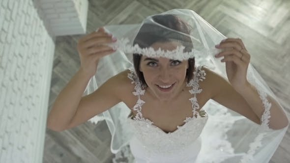 Thumbnail for Beautiful Charming Bride In a Luxurious Dress Looking Up. Beautiful Girl In a White