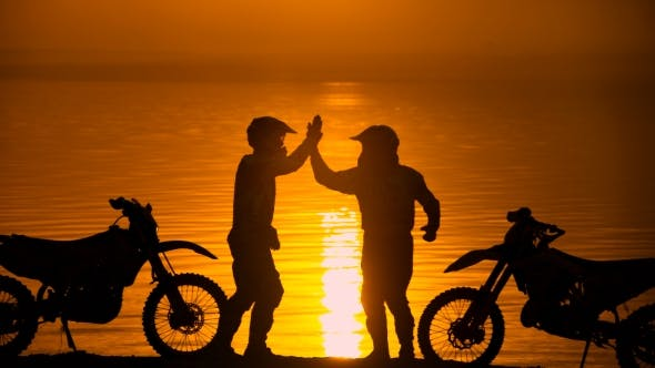 Thumbnail for Two Motorcyclists Met At Beoregu River At Sunset