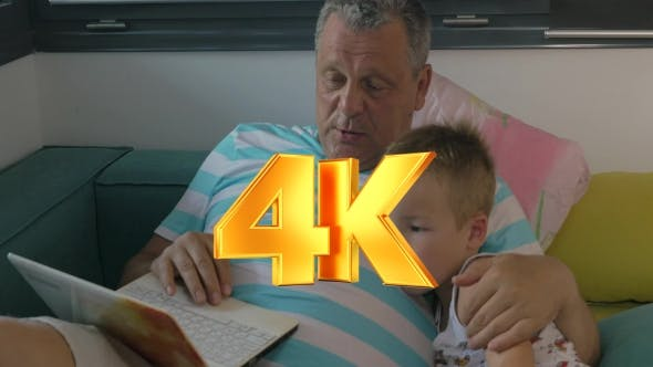 Thumbnail for Child And Grandfather Using Laptop At Home