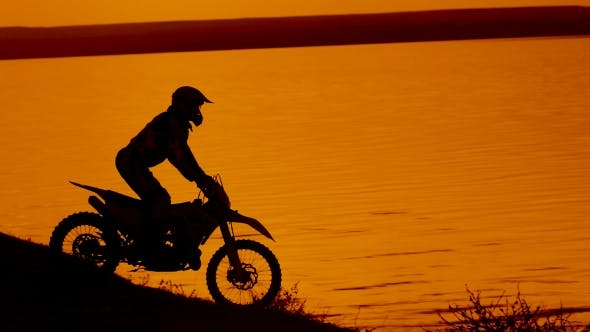 Motorcyclist Silhouette at Sunset