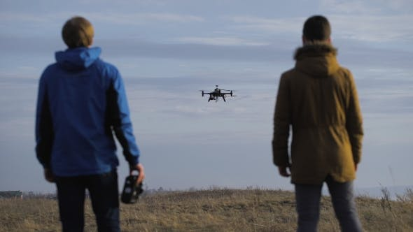 Thumbnail for Two Engineers Watching The Drone Landing