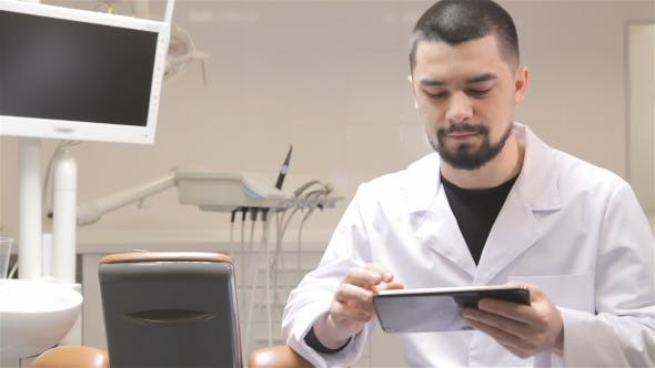 Thumbnail for Dentist Uses Tablet In His Cabinet
