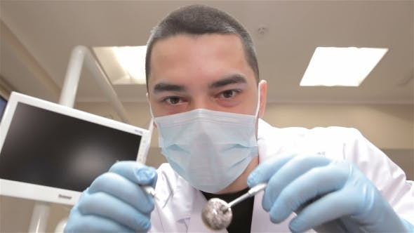 Thumbnail for Dentist Examines Patient