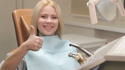 Woman Okays Checkup At The Dentist
