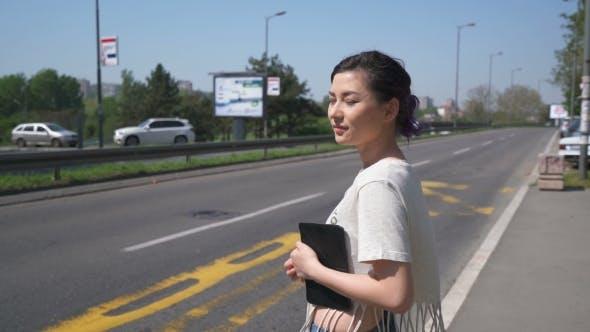 Thumbnail for Pretty Girls Waiting a Bus