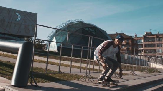 Thumbnail for Skateboarder Does Flip At Street