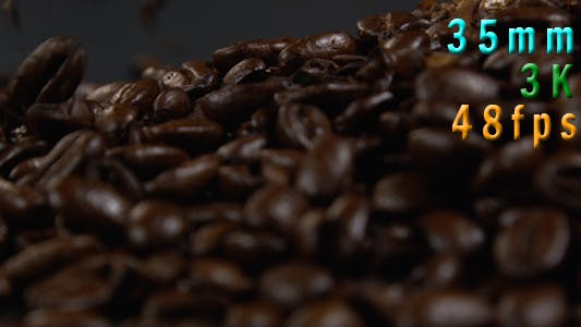 Thumbnail for Coffee beans falling on a black table 32