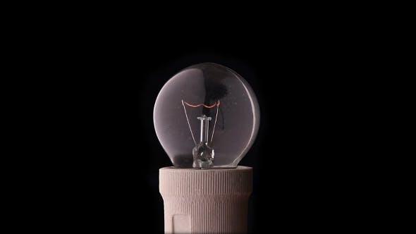Thumbnail for Light Bulb On Black Background