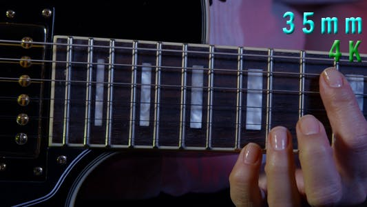 Thumbnail for Woman Playing Electrical Guitar 19