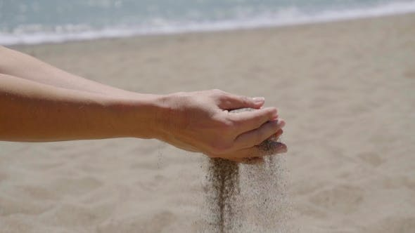 Thumbnail for Stream Of Sand Pouring From Hands