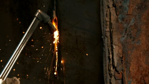 Thumbnail for Worker Cutting Metal With Acetylene Torch
