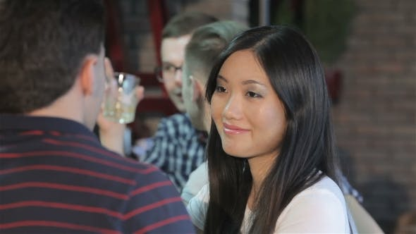 Thumbnail for Of Asian Girl Drinks Wine At The Bar