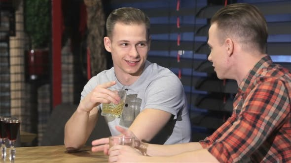 Thumbnail for Two Twins Drinking Alcohol At The Bar