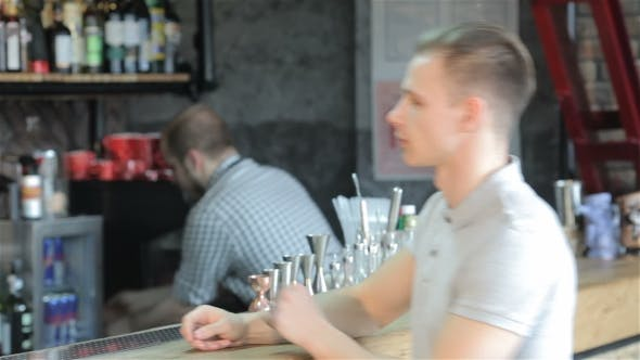 Thumbnail for Man Orders Beer At The Bar