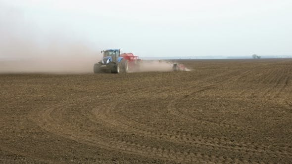 Thumbnail for Tractor Ploughs Tills Plows And Seeds On The Field