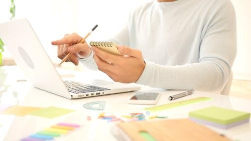 Creative Freelance Designer Working and Writing
