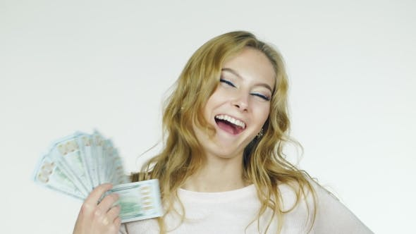 Thumbnail for An Attractive Woman With a Fan Of Money