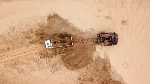 Thumbnail for Directly Above View of Excavator Pours Sand Into the Truck. On the Construction Site