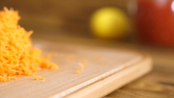 Thumbnail for Grated Carrots On a Wooden Board