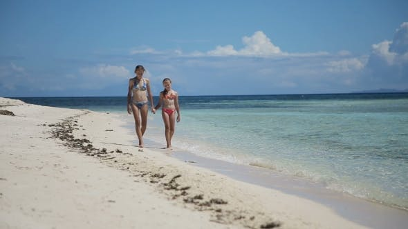 Thumbnail for Two Girls Walking On a Tropical Beach