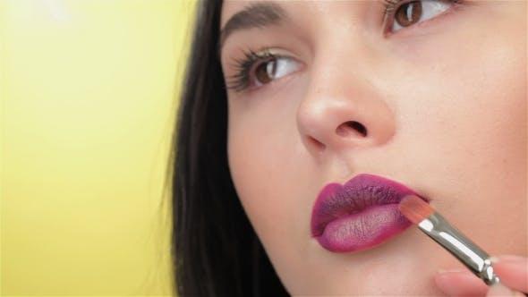 Thumbnail for Visagist Paints Lips Of Brunette Girl