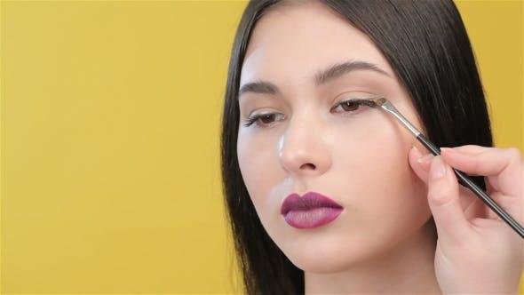 Of Visagist Applies An Eyeliner