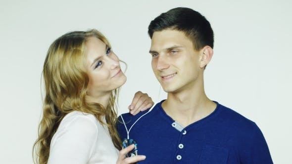 Thumbnail for Young Couple Listening To Music On Headphones