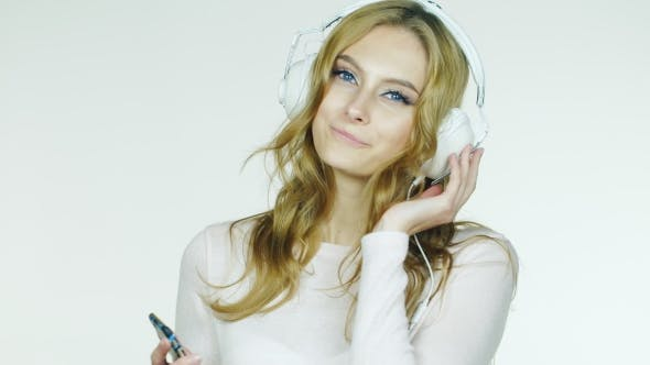 Thumbnail for Attractive Woman Listening To Romantic Music On Headphones