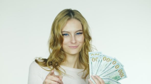 Cover Image for Attractive Woman Shows a Fan Of Money Concept