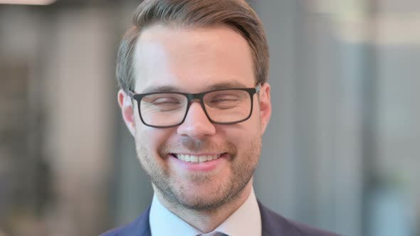 Face Close up of Businessman Smiling at Camera