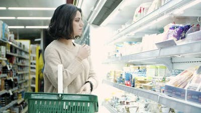 Woman Choosing Products in Store