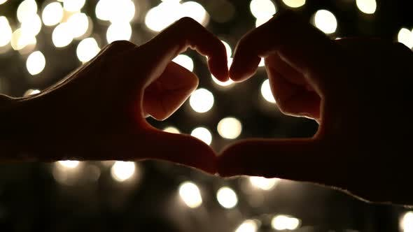 Thumbnail for Couple Hands With Love Symbol On Bokeh Lights Background