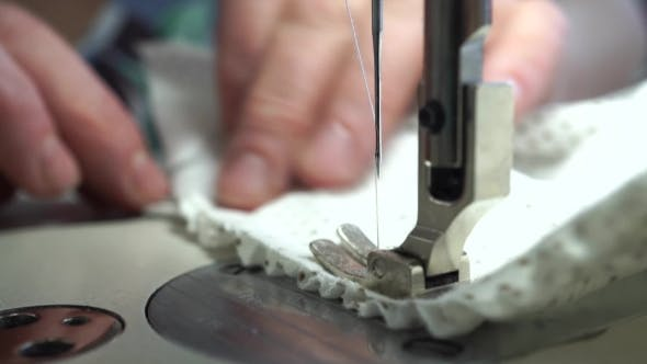 Thumbnail for Factory Seamstress At Work And Industrial Sewing Machine