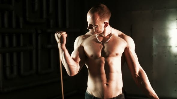 Thumbnail for Strong Muscular Man Exercising With Expander