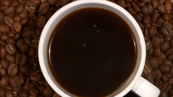 Thumbnail for White Cup with Coffee Stands on Brown Beans, Sacking, Close Up, Rotation