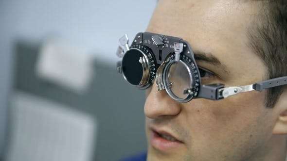 Thumbnail for An Ophthalmologist Is Checking a Man's Vision