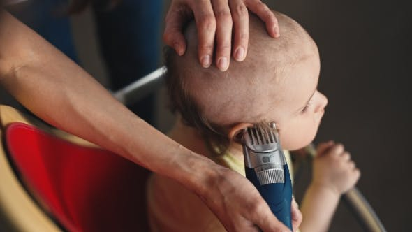 Thumbnail for Mother Doing a Haircut For a Baby Boy With a Hair Clipper