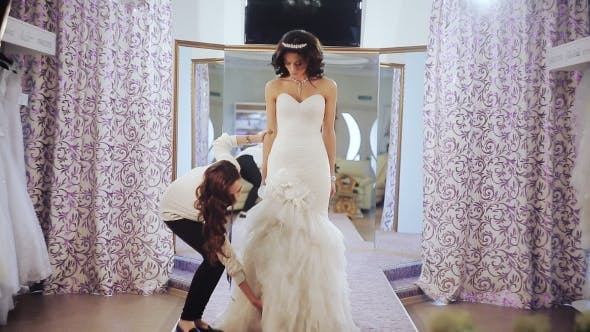Thumbnail for Designer Wedding Salon Measures a Young Girl To Choose Dress Size