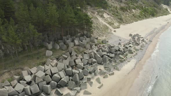 Thumbnail for Concrete Tetrapods Laying On The Beach Front