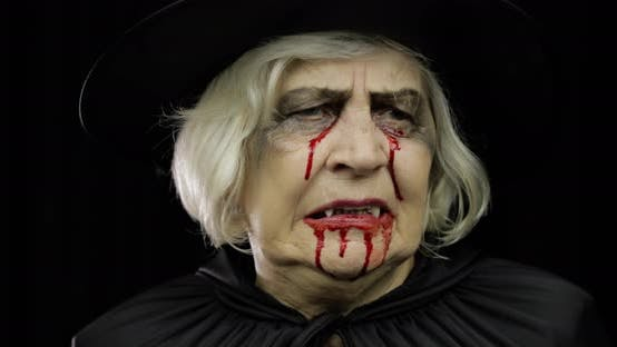 Thumbnail for Old Witch Halloween Makeup. Elderly Woman Portrait with Blood on Her Face.