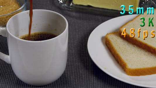 Thumbnail for Coffee Being Poured Next To Buttered Toast On a Plate 21