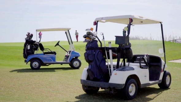 Thumbnail for Two Golf Carts Loaded With Bags And Clubs
