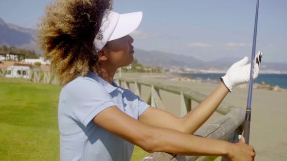 Thumbnail for Young Woman Player On a Seafront Golf Course