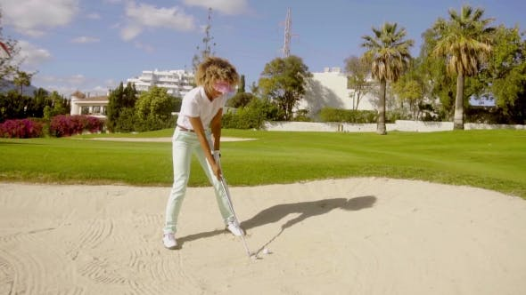 Thumbnail for Young Woman Golfer Playing Out Of a Bunker