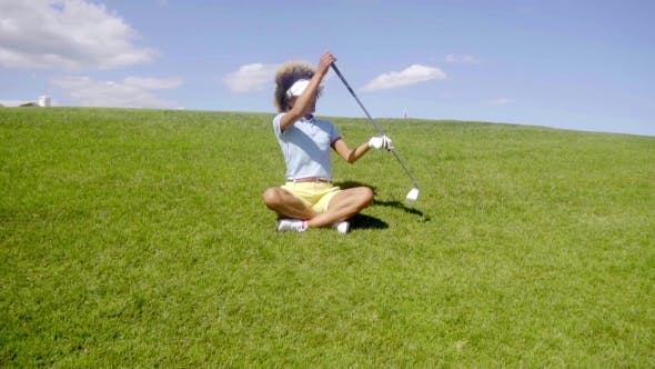 Thumbnail for Young Woman Golfer Sitting In The Fairway