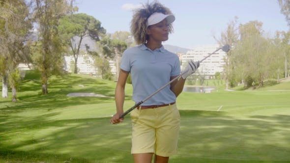 Thumbnail for Attractive Woman Golfer Walking On The Course