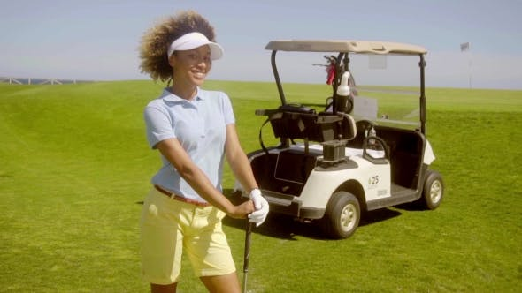 Thumbnail for Attractive Female Golfer With a Golf Cart