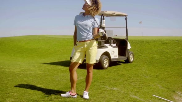 Thumbnail for Young Woman Golfer Standing Above a Sand Bunker